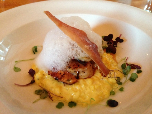Another delicious starter of scallops over saffron risotto.