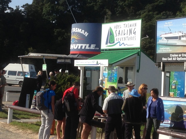 The crowd forms early for the shuttles to various parts of Abel Tasman National Park.