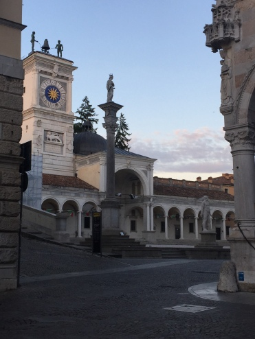 The Loggia di San Giovanni and its clock tower, the Torre dell'Orologio, dominate the city's principal square, the Piazza della Libertà.